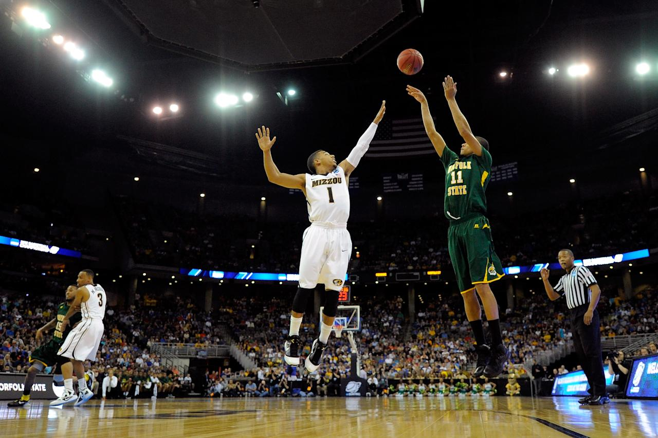 OMAHA, NE - MARCH 16:  Pendarvis Williams #11 of the Norfolk State Spartans attempts a shot against Phil Pressey #1 of the Missouri Tigers during the second round of the 2012 NCAA Men's Basketball Tournament at CenturyLink Center on March 16, 2012 in Omaha, Nebraska.  (Photo by Eric Francis/Getty Images)