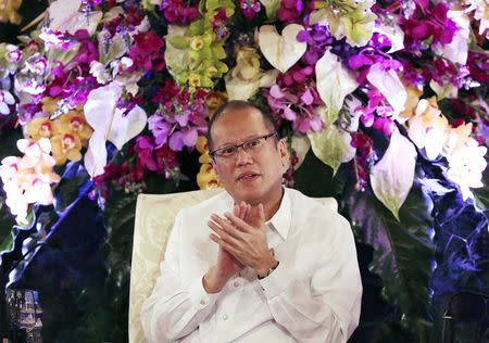 "Philippine President Aquino claps as he attends the conference ""Daylight Dialogue: The Good Governance Challenge"" at the presidential Malacanang Palace in Manila"