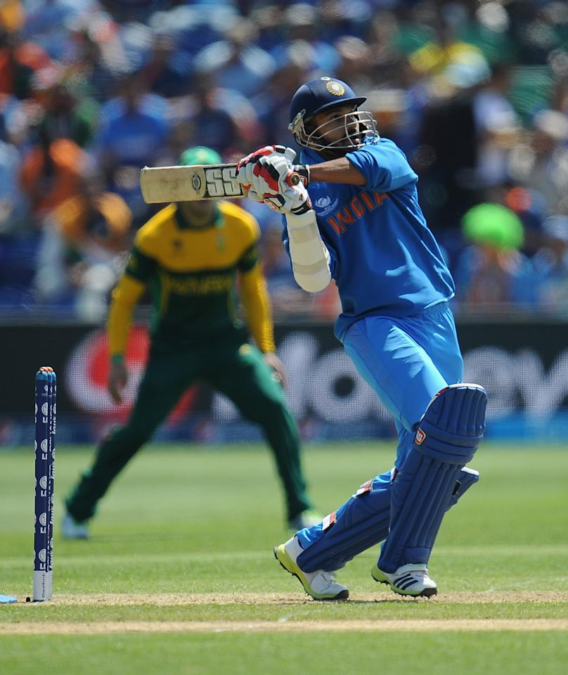 CARDIFF, WALES - JUNE 06:  Shikhar Dhawan of India in action as he heads for his century during the ICC Champions Trophy group B match between India and South Africa at Cardiff Stadium on June 6, 2013 in Cardiff, Wales.  (Photo by Christopher Lee-ICC/ICC via Getty Images)