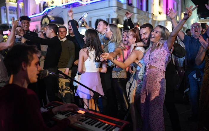 People were dancing, singing and hugging, with few maintaining social distance  - Peter Summers/Getty