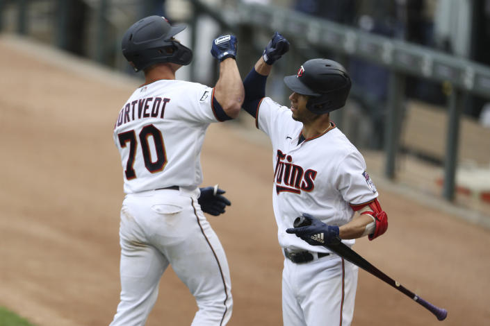 Minnesota Twins' Ben Rortvedt (7) high fives teammate Andrelton Simmons (9) after hitting a home run against the Kansas City Royals during the second inning of a baseball game Sunday, May 30, 2021, in Minneapolis. (AP Photo/Stacy Bengs)
