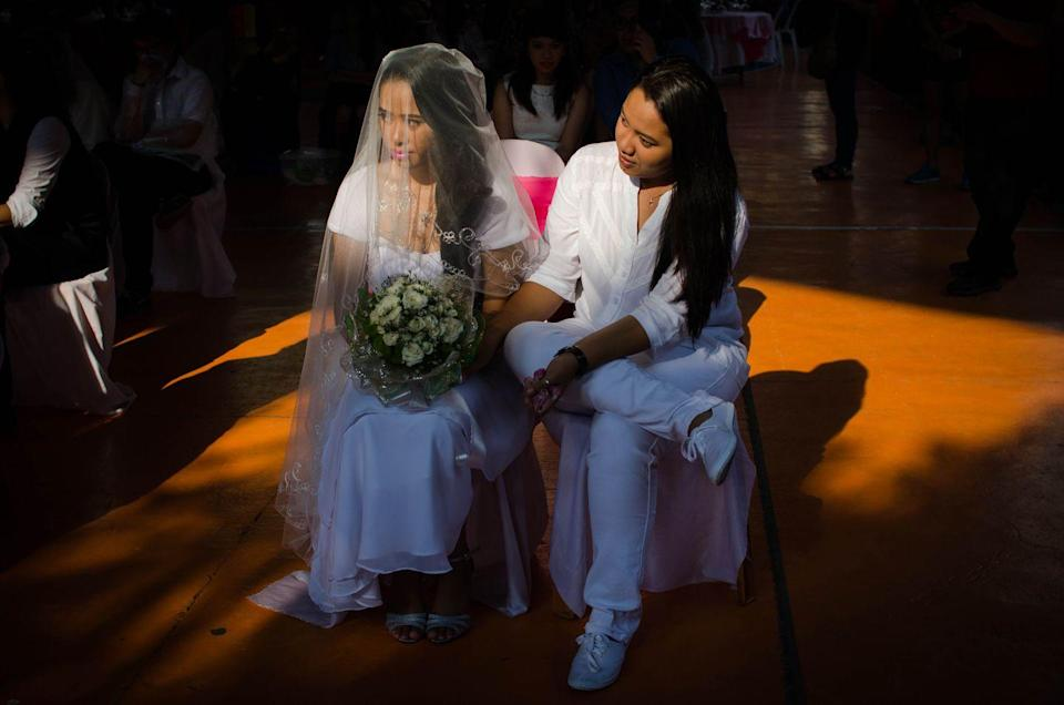 <p>Even though same-sex marriage is illegal in the Philippines, that didn't stop couples from exchanging vows during a mass ceremony early in 2020. <br></p>