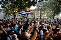 Cuban government supporters take part in a rally to condemn the media campaign in support of the San Isidro movement in Havana, November 2020