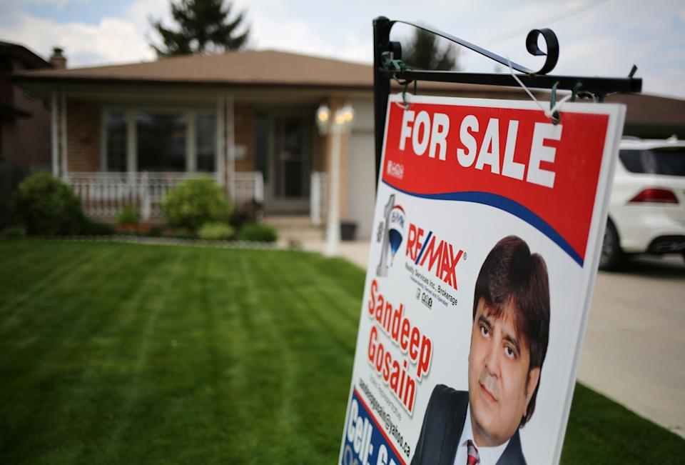 A house for sale through a realtor is seen in Hamilton, Ontario, Canada May 13, 2017. Picture taken May 13, 2017. REUTERS/Chris Helgren