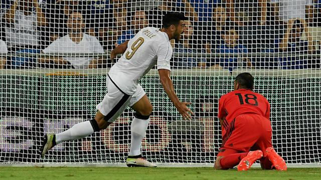 Graziano Pelle, Antonio Candreva and Ciro Immobile were on target for 10-man Italy in a 3-1 win in Israel on Monday.