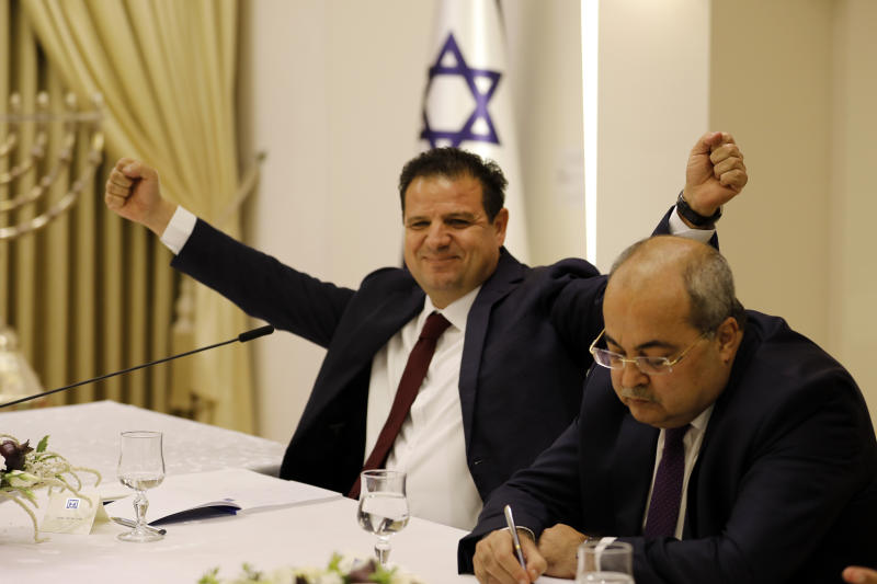 Members of the Joint List Ayman Odeh, left and Ahmad Tibi during a consultation meeting with Israeli President Reuven Rivlin in Jerusalem, Sunday, Sept. 22, 2019. Rivlin began two days of crucial talks Sunday with party leaders before selecting his candidate for prime minister, after a deadlocked repeat election was set to make forming any new government a daunting task. (Menahem Kahana/Pool via AP)