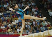 Romania's Larisa Andreea Iordache loses balance but does not fall as she competes in the balance beam during the women's individual all-around gymnastics final in the North Greenwich Arena during the London 2012 Olympic Games August 2, 2012.