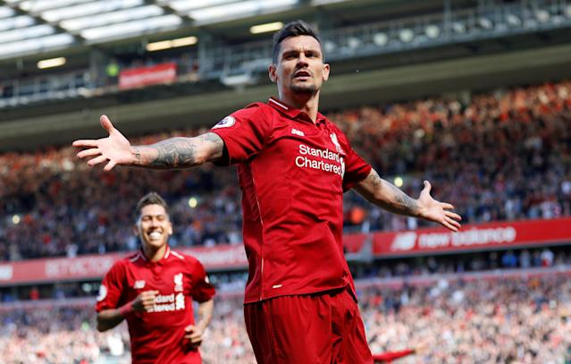 "Soccer Football - Premier League - Liverpool vs Brighton & Hove Albion - Anfield, Liverpool, Britain - May 13, 2018 Liverpool's Dejan Lovren celebrates scoring their second goal REUTERS/Phil Noble EDITORIAL USE ONLY. No use with unauthorized audio, video, data, fixture lists, club/league logos or ""live"" services. Online in-match use limited to 75 images, no video emulation. No use in betting, games or single club/league/player publications. Please contact your account representative for further details. TPX IMAGES OF THE DAY"