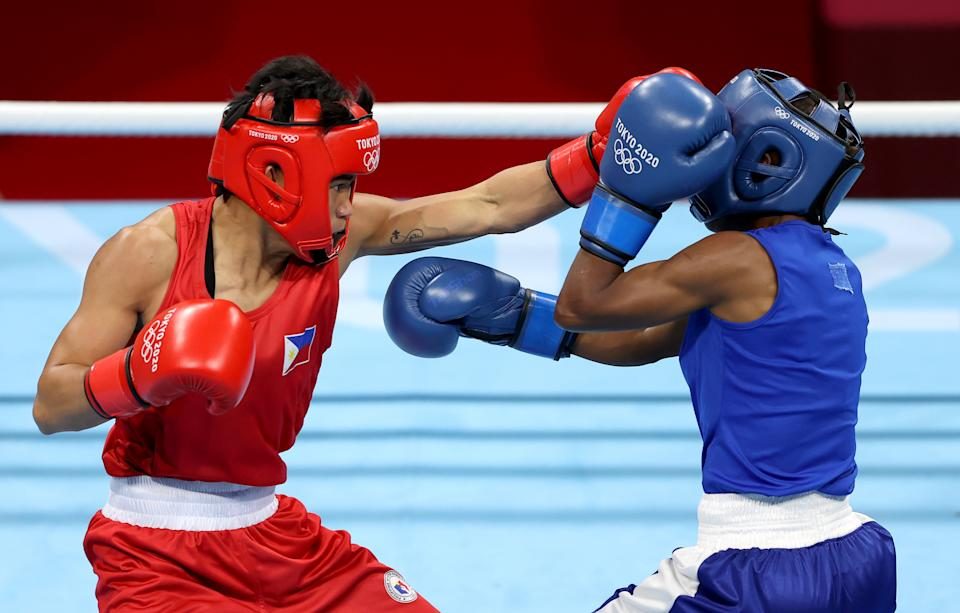 TOKYO, JAPAN - JULY 25: Irish Magno (L) of Philippines exchanges punches with Christine Ongare of Kenya during the Women's Fly (48-51kg) on day two of the Tokyo 2020 Olympic Games at Kokugikan Arena on July 25, 2021 in Tokyo, Japan. (Photo by James Chance/Getty Images)