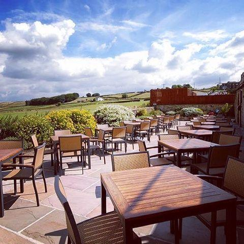 "<p>If you seek stunning views of the Yorkshire Dales, then the scenic Fleece Countryside Inn is the place to be. Enjoy your tipple of choice surrounded by the rolling hills of the Calder Valley, overlooking the village of Ripponden. </p><p>The pub's booking system is currently live and taking reservations from April 12th for the bottom terrace, complete with shelter. There's no booking required for use of the top terrace, which will open depending on the weather. </p><p><a href=""https://www.instagram.com/p/CMCQa5hhHr9/"" rel=""nofollow noopener"" target=""_blank"" data-ylk=""slk:See the original post on Instagram"" class=""link rapid-noclick-resp"">See the original post on Instagram</a></p>"