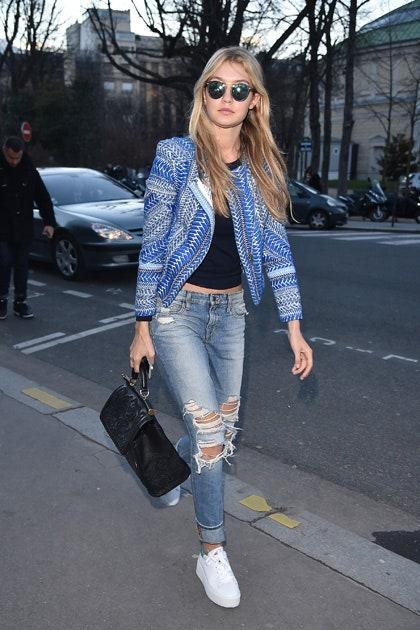 Cali girl alert! Clad in head-to-toe blue and sporting chic shades and comfy sneaks, this relaxed look has West Coast written all over it. Gigi knows how to rev it up with an embellished black leather bag.