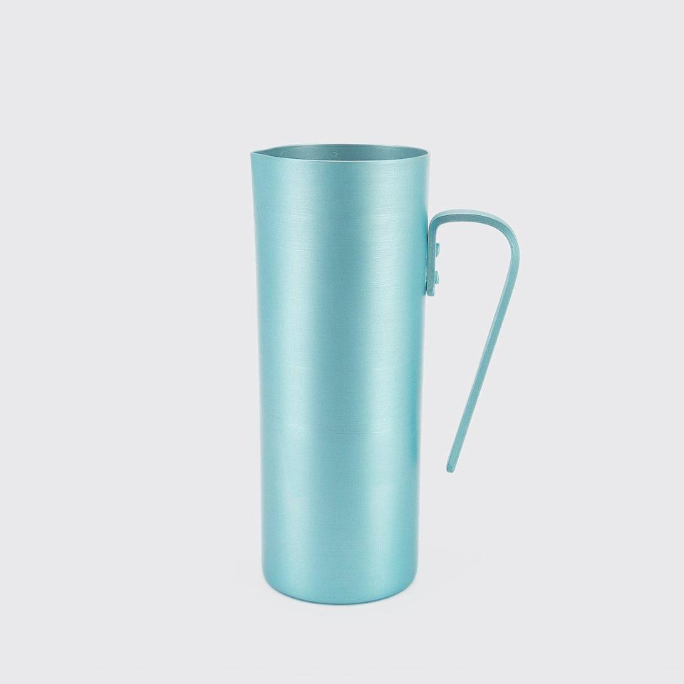 """With a delightful shade of blue and a simple silhouette, this aluminum pitcher will add color to your tablescape. $25, Utilitario Mexicano. <a href=""""https://www.utilitariomexicano.com/en/products/10010012674"""" rel=""""nofollow noopener"""" target=""""_blank"""" data-ylk=""""slk:Get it now!"""" class=""""link rapid-noclick-resp"""">Get it now!</a>"""