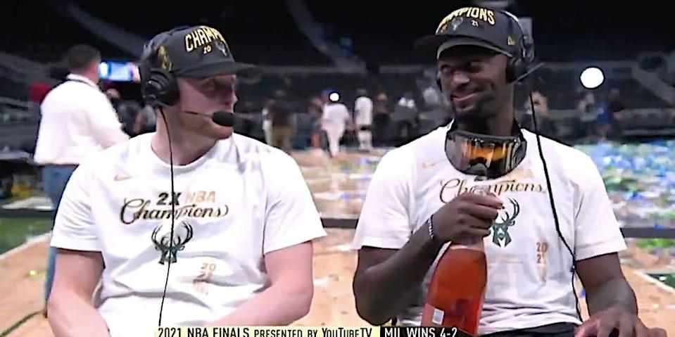 Pat Connaughton and Bobby Portis look at each other during a postgame interview.