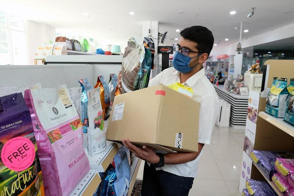 Dalbinder collects items ordered by customers to be sent to them. ― Picture by Steven KE Ooi