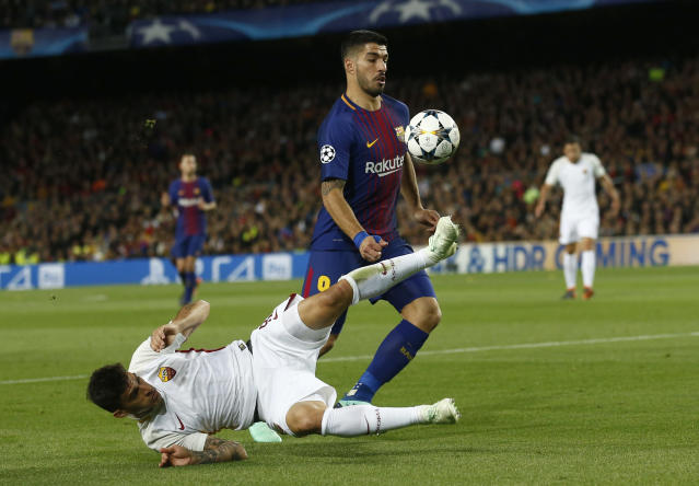 Roma's Diego Perotti tries to stop Barcelona's Luis Suarez during the Champions League quarterfinal first leg at Camp Nou. (AP)