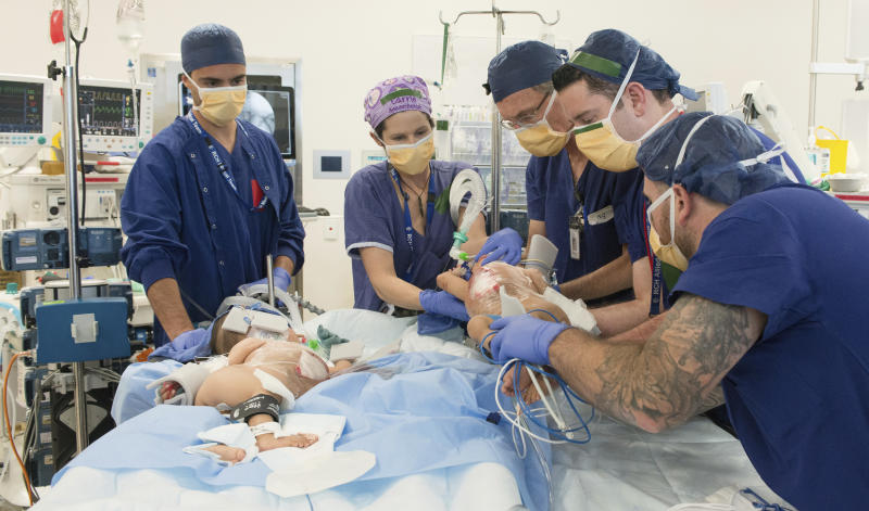 This photo provided by RCH Melbourne Creative Studio, shows surgery on the 15-month-old girls at the Royal Children's Hospital Melbourne, Australia Friday, Nov. 8, 2018. Surgeons in Australia have begun separating the conjoined twins from Bhutan in a delicate operation expected to last most of the day. (RCH Melbourne Creative Studio via AP)