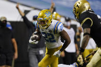 UCLA running back Keegan Jones, left, runs for a touchdown as Colorado safety Derrion Rakestraw tries to make the stop in the second half of an NCAA college football game Saturday, Nov. 7, 2020, in Boulder, Colo. (AP Photo/David Zalubowski)