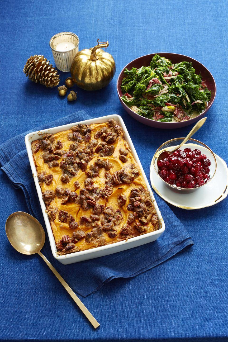 """<p>A staple on every Thanksgiving table, this sweet casserole is such a treat you could even save it for the end of the meal.<br></p><p><a href=""""https://www.womansday.com/food-recipes/food-drinks/recipes/a56472/sweet-potato-casserole-with-brown-sugared-pecans-recipe/"""" rel=""""nofollow noopener"""" target=""""_blank"""" data-ylk=""""slk:Get the Sweet Potato Casserole with Brown-Sugared Pecans recipe."""" class=""""link rapid-noclick-resp""""><em><strong>Get the Sweet Potato Casserole with Brown-Sugared Pecans recipe.</strong></em></a> </p>"""