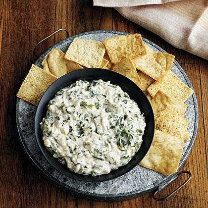"""<p><strong>Recipe:</strong> <a href=""""https://www.southernliving.com/syndication/cheesy-spinach-crab-dip"""" rel=""""nofollow noopener"""" target=""""_blank"""" data-ylk=""""slk:Cheesy-Spinach Crab Dip"""" class=""""link rapid-noclick-resp"""">Cheesy-Spinach Crab Dip</a></p> <p>Pop the champagne and dig into this dreamy spinach and crab dip. We won't blame you if you eat only this dip at brunch.</p>"""
