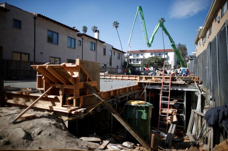 People work on a construction site to build a new apartment building in Los Angeles, California