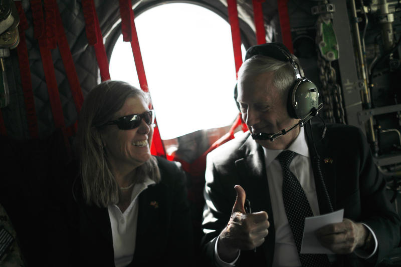 KABUL, AFGHANISTAN - APRIL 24: U.S. Defense Secretary James Mattis (R) gives senior advisor Sally Donnelly (L) a thumbs-up as they discuss their schedule upon arriving via helicopter at Resolute Support headquarters on April 24, 2017 in in Kabul, Afghanistan. Mattis is on a regional tour of the Middle East. (Photo by Jonathan Ernst - Pool/Getty Images)