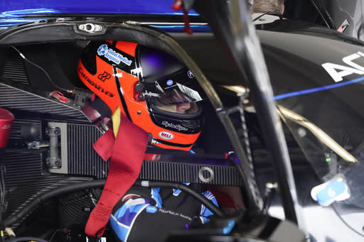 Helio Castroneves prepares to go out on the track for a practice session for the Rolex 24 hour auto race at Daytona International Speedway, Saturday, Jan. 23, 2021, in Daytona Beach, Fla. (AP Photo/John Raoux)