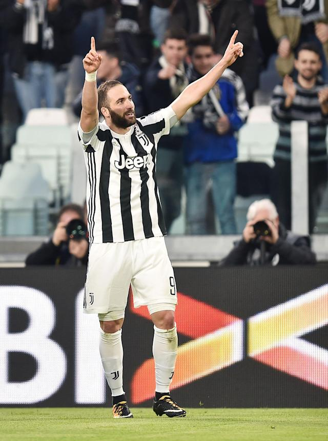 Juventus' Gonzalo Higuain celebrates after scoring his side's first goal during the Italian Serie A soccer match between Juventus and Atalanta at the Allianz Stadium in Turin, Italy, Wednesday, March 14, 2018. (Alessandro Di Marco/ANSA via AP)
