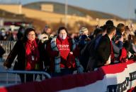 Supporters of US President Donald Trump gather at Joint Base Andrews in Maryland for Trump's departure on January 20, 2021. - President Trump travels to his Mar-a-Lago golf club residence in Palm Beach, Florida, and will not attend the inauguration for President-elect Joe Biden. (Photo by ALEX EDELMAN / AFP) (Photo by ALEX EDELMAN/AFP via Getty Images)