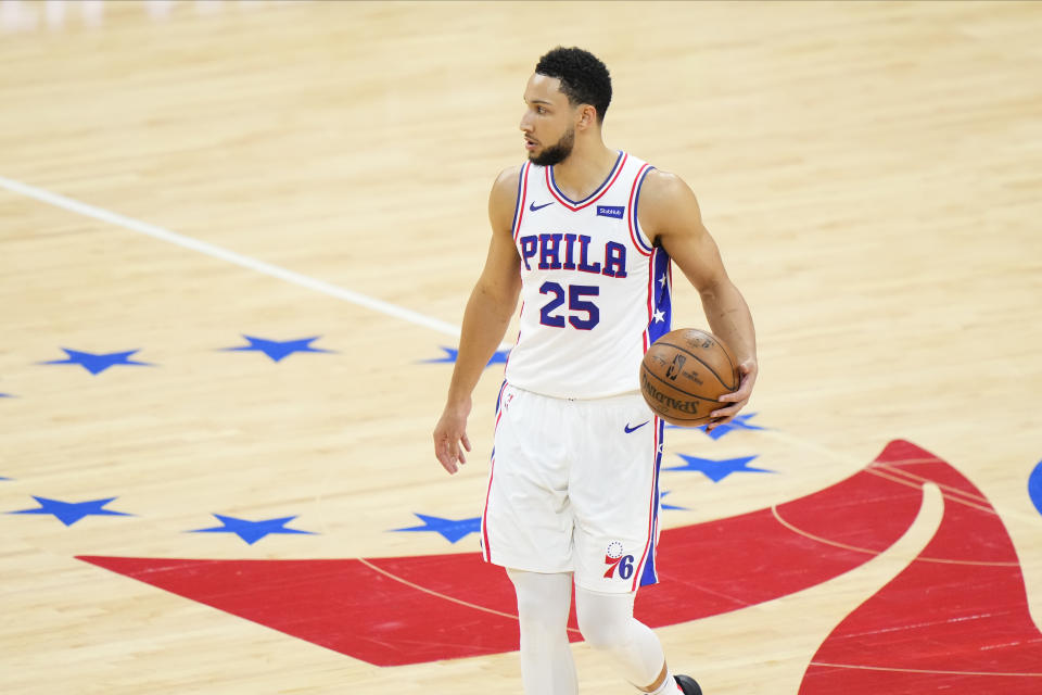 Ben Simmons with the ball in his hand at midcourt.