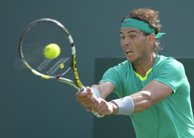 Rafael Nadal, of Spain, makes a return against Juan Martin del Potro, of Argentina, during their match at the BNP Paribas Open tennis tournament, Sunday, March 17, 2013, in Indian Wells, Calif. (AP Photo/Mark J. Terrill)
