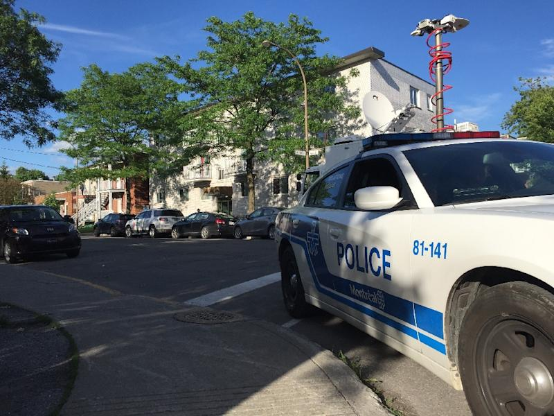 Police guard the building in Montreal where Flint airport stabbing suspect Amor Ftouhi lived before traveling to the United States