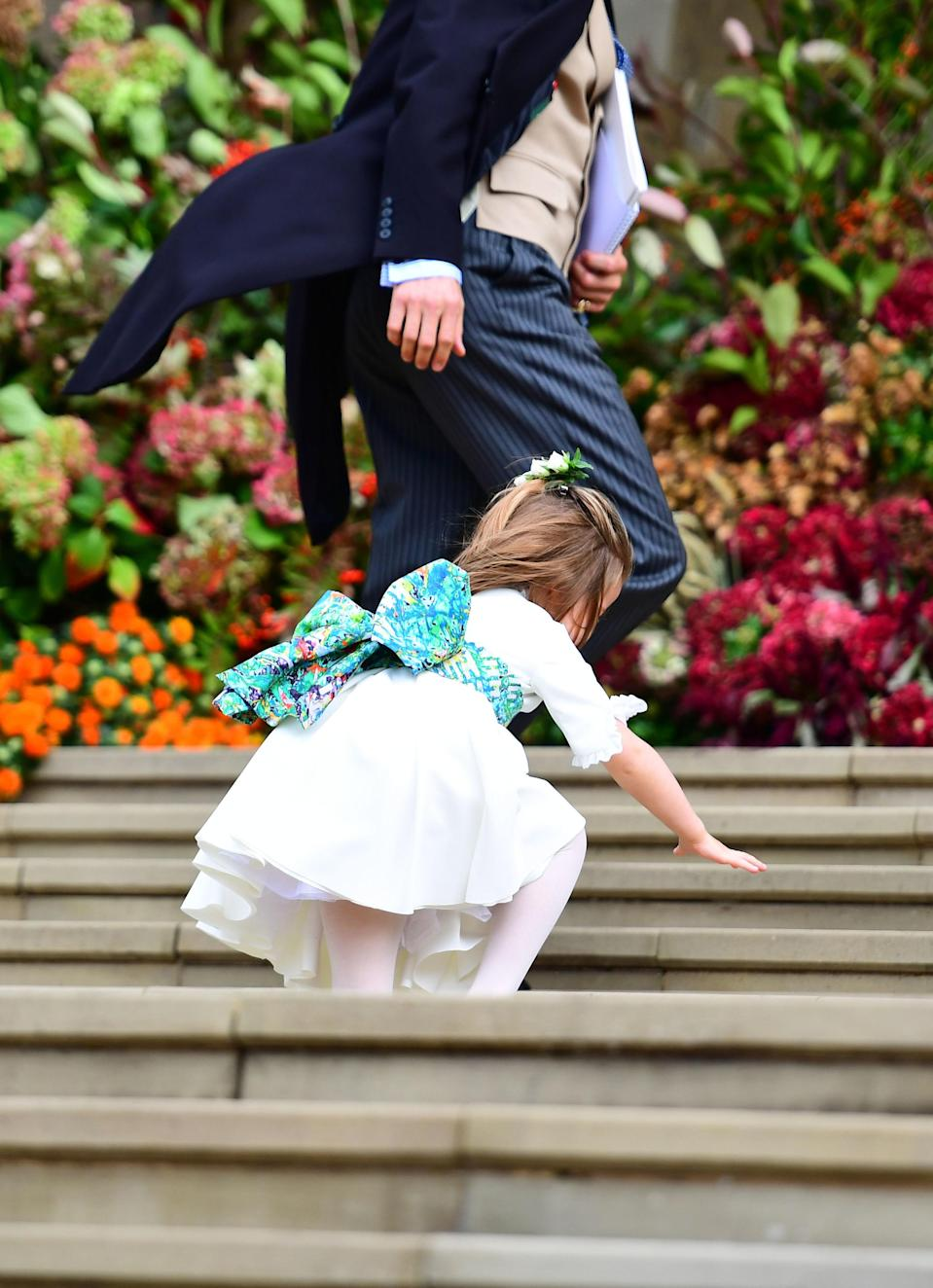 Princess Charlotte had a rough-go on the chapel steps! Image via Getty Images.