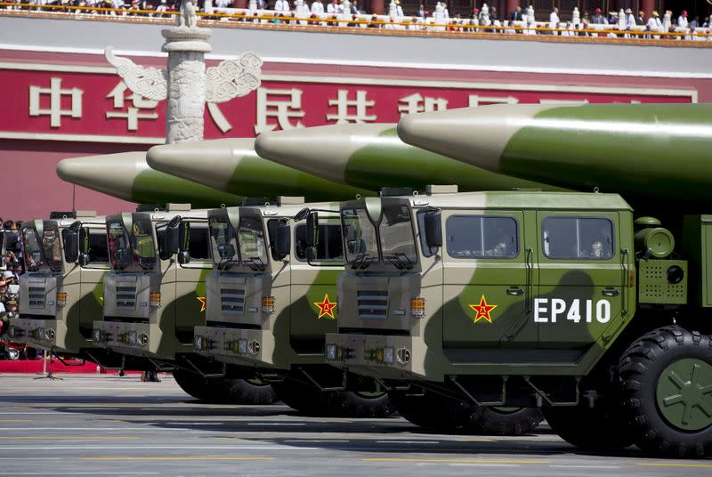 FILE PHOTO: Military vehicles carrying DF-26 ballistic missiles travel past Tiananmen Gate during a military parade to commemorate the 70th anniversary of the end of World War II in Beijing
