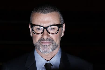 FILE PHOTO - British singer George Michael poses for photographers before a news conference at the Royal Opera House in central London May 11, 2011.   REUTERS/Stefan Wermuth/File Photo