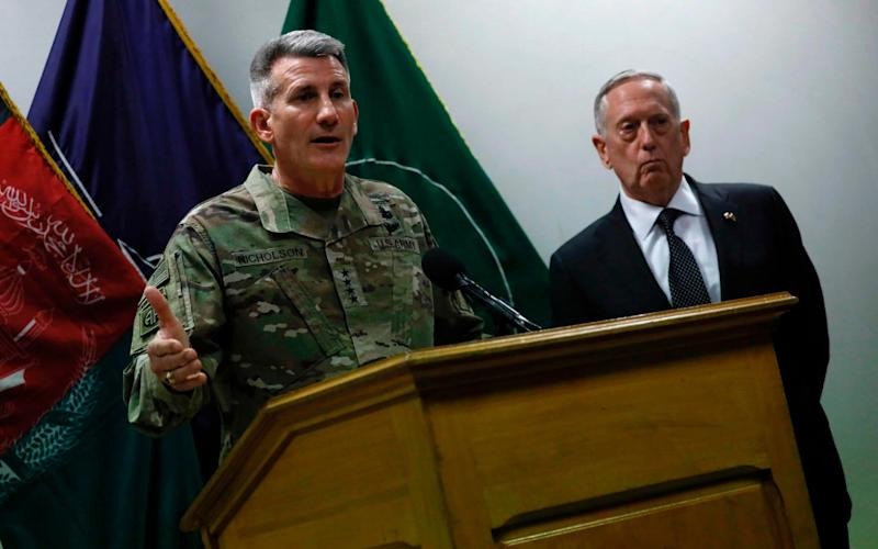 US Defense Secretary James Mattis (R) and US Army General John Nicholson (L), commander of US forces in Afghanistan, hold a news conference at Resolute Support headquarters in Kabul on April 24, 2017 - AFP
