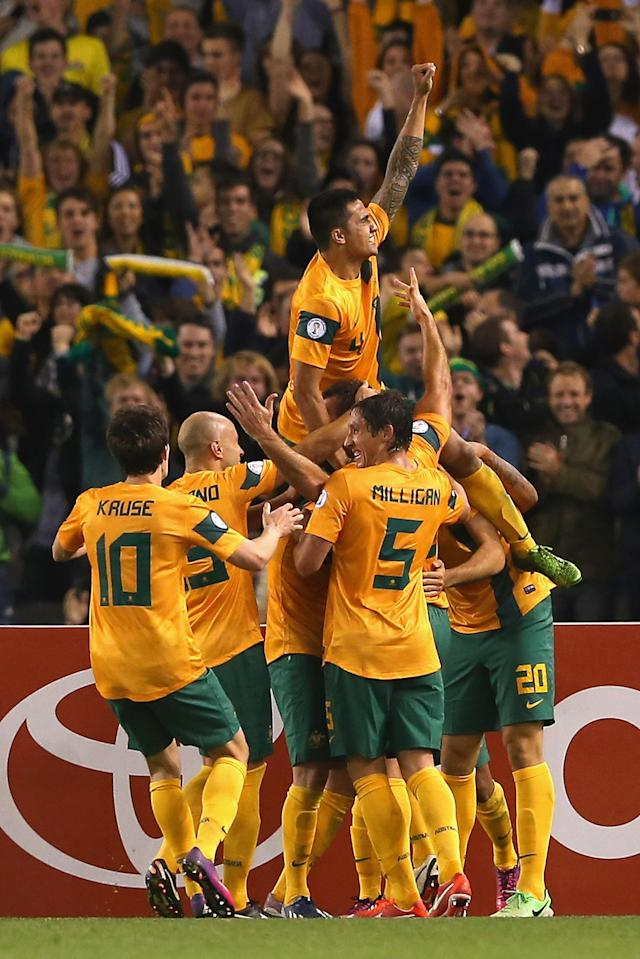 MELBOURNE, AUSTRALIA - JUNE 11: Lucas Neill of Australia is congratulated by team mates after scoring a goal during the FIFA World Cup Qualifier match between the Australian Socceroos and Jordan at Etihad Stadium on June 11, 2013 in Melbourne, Australia. (Photo by Quinn Rooney/Getty Images)