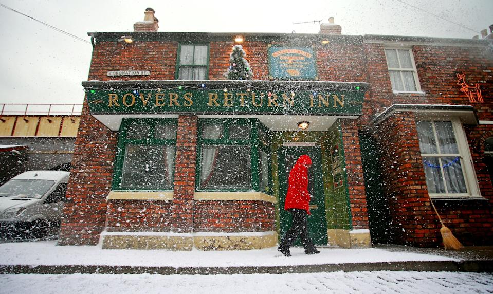 The Rovers Return Inn on the Coronation Street film-set located in fictional Weatherfield, Salford, Manchester, where it has been decked inside and out for Christmas with false snow and decorations.