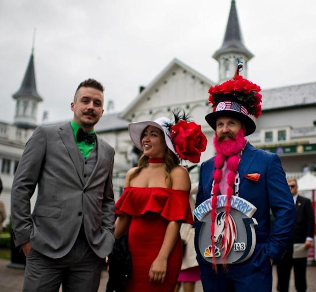 <p>Mustaches, beards, hats, colors — everything in sync for strutting around Churchill Downs. (Photo: Scott Serio/Eclipse Sportswire/Getty Images) </p>