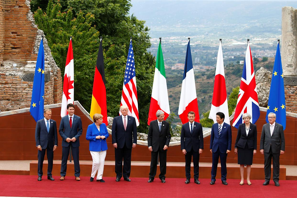 (Left to right) European Council President Donald Tusk, Canadian Prime Minister Justin Trudeau, German Chancellor Angela Merkel, U.S. President Donald Trump, Italian Prime Minister Paolo Gentiloni, French President Emmanuel Macron, Japanese Prime Minister Shinzo Abe, British Prime Minister Theresa May and European Commission President Jean-Claude Juncker pose for a family photo during the G7 Summit in Taormina, Sicily, on May 26, 2017.
