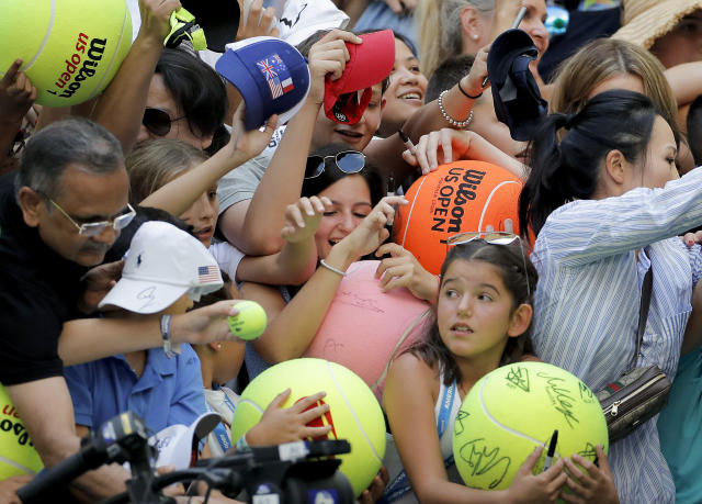 FILE - In this Aug. 31, 2019, file photo, tennis fans crowd the edge of the court hoping for an autograph from Rafael Nadal, of Spain, during round three of the U.S. Open tennis championships in New York. The U.S. Tennis Association intends to hold the U.S. Open Grand Slam tournament in New York starting in August without spectators, if it gets governmental support -- and a formal announcement could come this week. (AP Photo/Eduardo Munoz Alvarez, File)