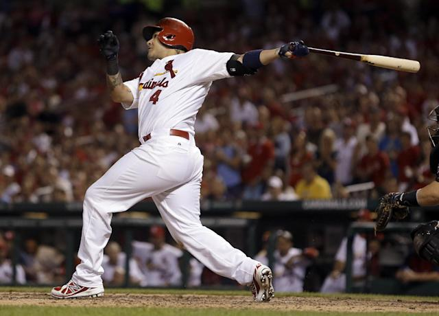 St. Louis Cardinals' Yadier Molina follows through on a three-run home run during the seventh inning of a baseball game against the Pittsburgh Pirates Friday, Sept. 6, 2013, in St. Louis. (AP Photo/Jeff Roberson)