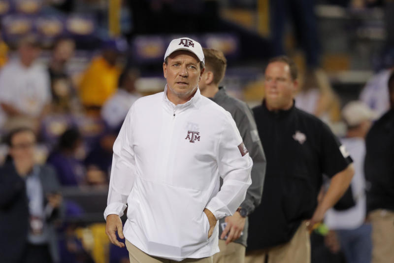 NCAA penalizes Texas A&M, Fisher for recruiting violations