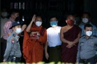 Fugitive Buddhist nationalist monk Wirathu hands himself in at a police station in Yangon