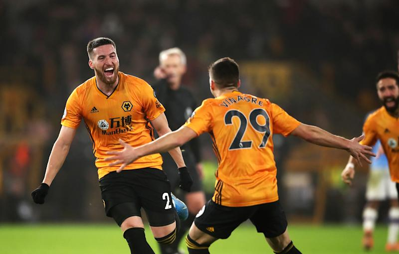 Wolverhampton Wanderers' Matt Doherty (left) celebrates scoring his side's third goal of the game with Ruben Vinagre during the Premier League match at Molineux, Wolverhampton. (Photo by Nick Potts/PA Images via Getty Images)