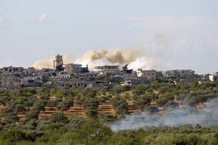Smoke rises in Maatarm town after what activists said was shelling by forces loyal to Syria's President Bashar al-Assad near the northwestern city of Ariha May 30, 2015, after a coalition of insurgent groups seized the area in Idlib province. Picture taken May 30, 2015. REUTERS/Khalil Ashawi