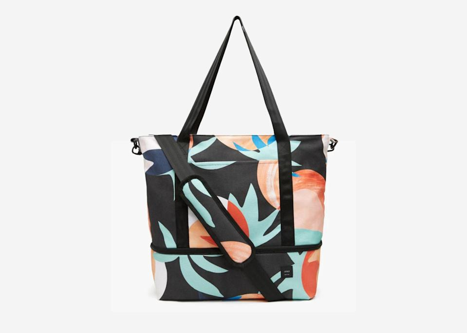 """<p>This tote is spacious enough to fit a long weekend's worth of yoga-to-beach outfits, making it perfect for a few days on that much-needed retreat in <a href=""""https://www.cntraveler.com/destinations/mexico-city?mbid=synd_yahoo_rss"""" rel=""""nofollow noopener"""" target=""""_blank"""" data-ylk=""""slk:Mexico"""" class=""""link rapid-noclick-resp"""">Mexico</a> or Costa Rica. We especially like the handy bottom compartment, which comes with a removable padded insert that helps keep shoes or workout clothes separate from everything else. Choose the <a href=""""https://fave.co/2pUPQHv"""" rel=""""nofollow noopener"""" target=""""_blank"""" data-ylk=""""slk:classic dark denim shade"""" class=""""link rapid-noclick-resp"""">classic dark denim shade</a> to pair nicely with the rest of your bags, or the brighter floral pattern shown above for a fun pop of color.</p> <p><strong>Buy now:</strong> <a href=""""https://fave.co/3h9z7GL"""" rel=""""nofollow noopener"""" target=""""_blank"""" data-ylk=""""slk:$295, onia.com"""" class=""""link rapid-noclick-resp"""">$295, onia.com</a></p>"""