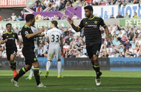 Britain Soccer Football - Swansea City v Chelsea - Premier League - Liberty Stadium - 11/9/16 Chelsea's Diego Costa celebrates with Eden Hazard after scoring their first goal Reuters / Rebecca Naden