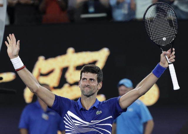 Serbia's Novak Djokovic celebrates after defeating United States' Mitchell Krueger in their first round match at the Australian Open tennis championships in Melbourne, Australia, Tuesday, Jan. 15, 2019. (AP Photo/Kin Cheung)
