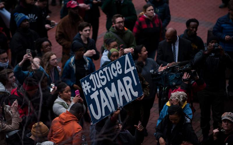 Protestors outside the Hennepin County Courthouse on March 30, 2016 in Minneapolis, after Hennepin County Attorney Mike Freeman announced there would be no charges brought against the officers involved in the death of Jamar Clark in November 2015 - Stephen Maturen/Getty Images North America