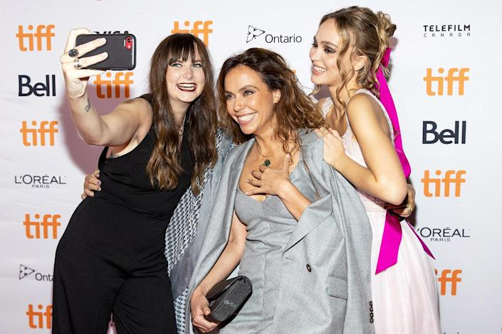 <p>Jessie Fisk, Nathalie Biancheri and Lily-Rose Depp take a group selfie at the premiere of <em>Wolf </em>at the 2021 Toronto International Film Festival on Sept. 17 in Canada.</p>